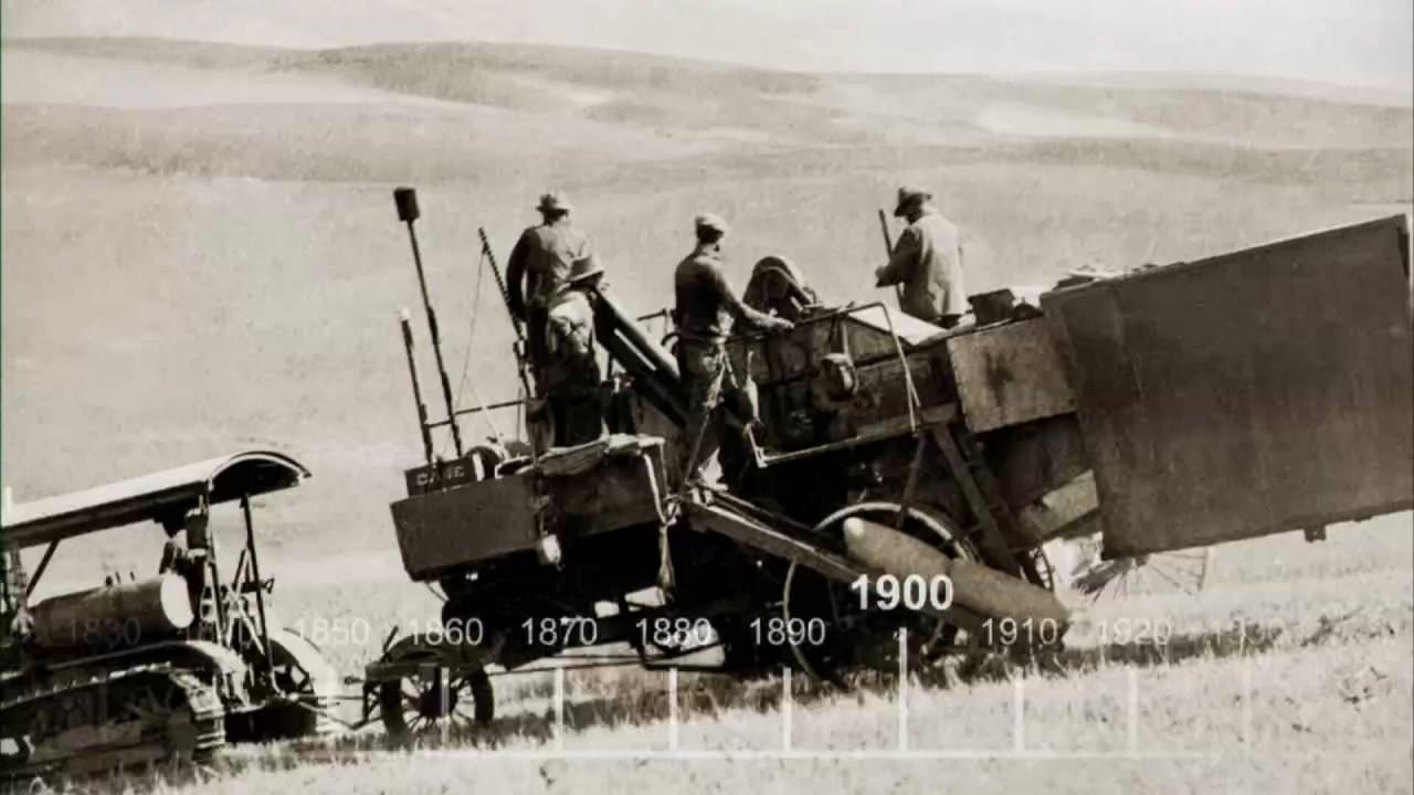 Industrielle Revolution der Landwirtschaft. Das Bild zeigt eine dampfgetriebene Erntemaschine.