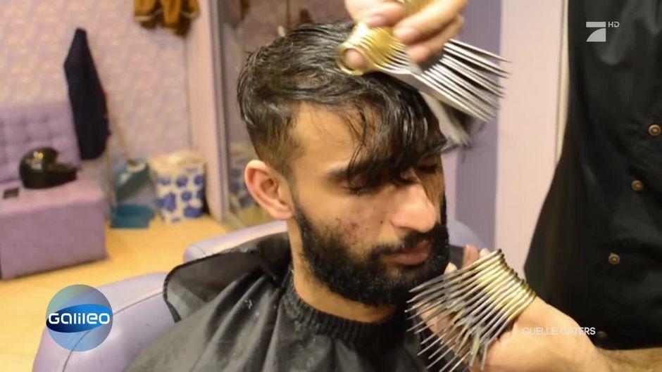 Der Friseur mit den Scherenhänden