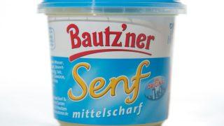 Bautz'ner Senf steht bis heute im Supermarkt. Der Mostrich wird noch immer in Sachsen hergestellt, obwohl die ostdeutsche Marke 1992 von einem bayerischen Unternehmen aufgekauft wurde.