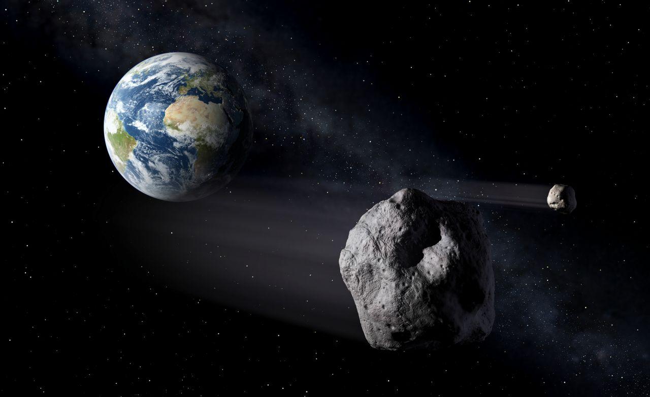 Erde und Asteroid in künstlerischer Darstellung