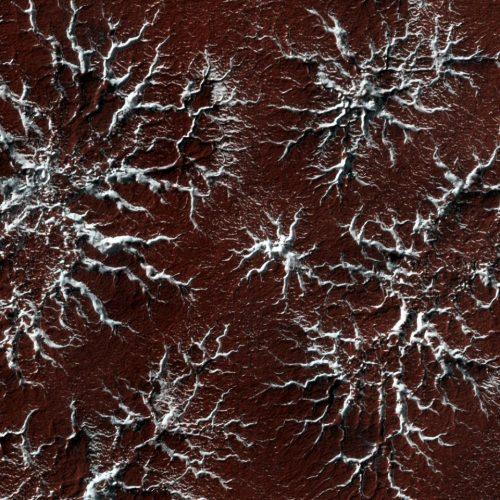 Die spinnenartigen Strukturen entstehen, wenn eiskaltes Kohlendioxideis auf erwärmten Marsboden trifft.